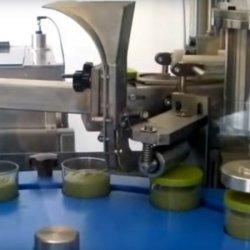 Máquina automática de llenado y taponado para cremas para untar